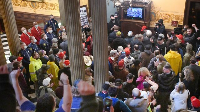 Protesters, some armed, enter Michigan Capitol